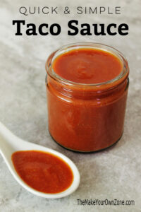 Jar of homemade taco sauce with spoon