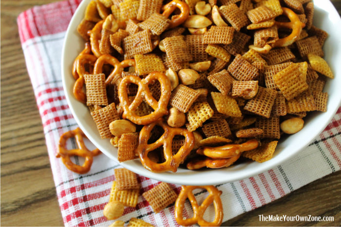 Homemade snack mix with chex, pretzels, and peanuts