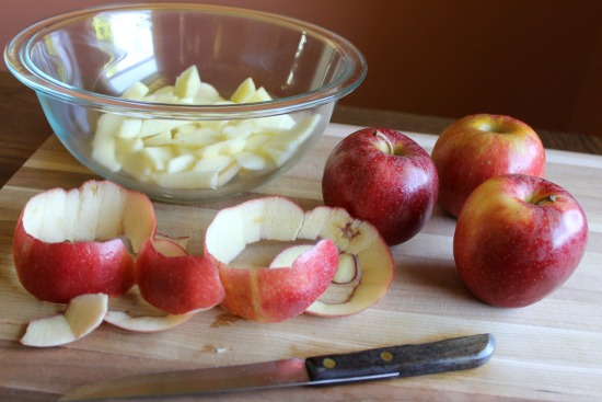 Wooden cutting board with apples