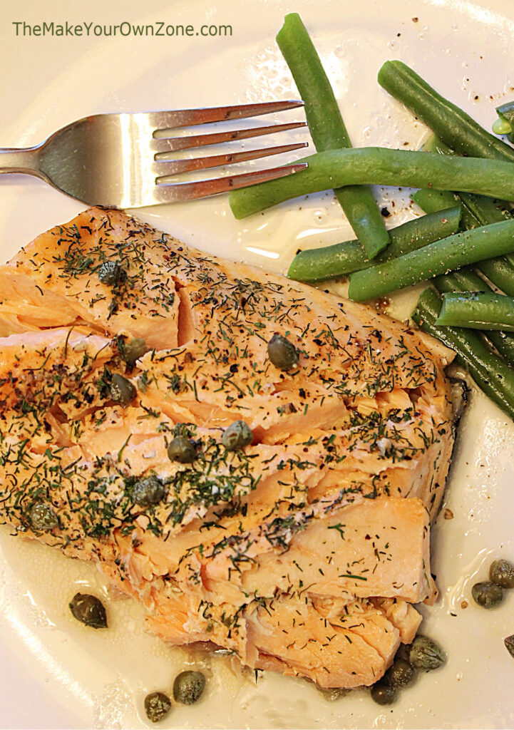 Salmon on a plate with green beans