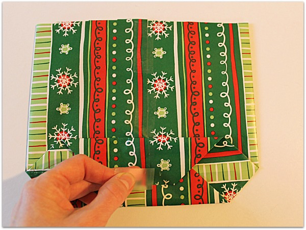 Tape (or glue) the piece together in the middle where it is overlapping.