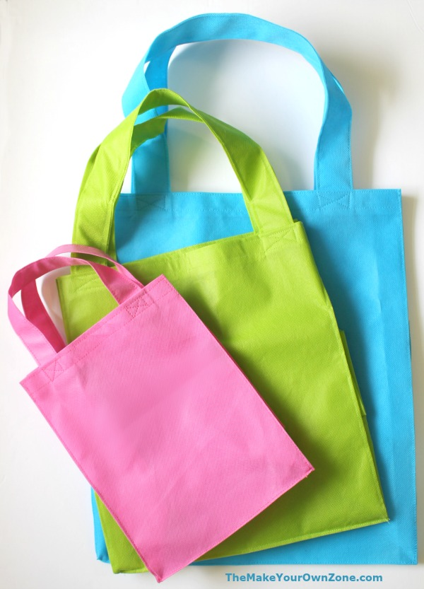 three sizes of homemade tote bags