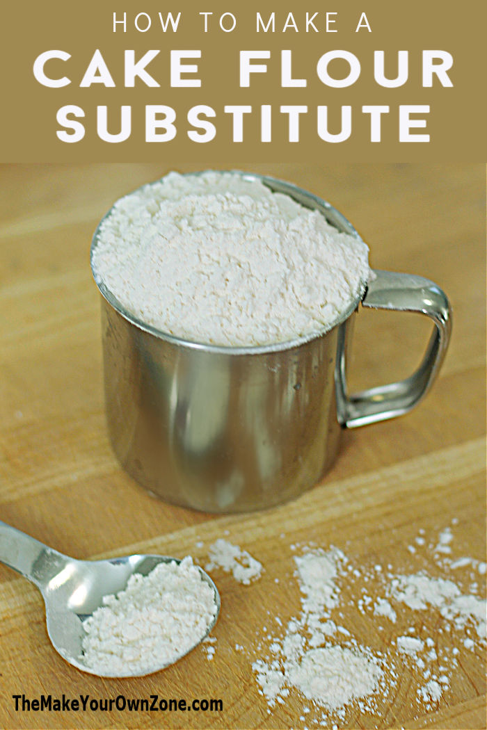 Homemade cake flour in a tin cup with spoon
