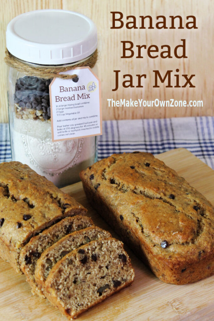 Banana bread mix in a jar with baked loaves of homemade banana bread
