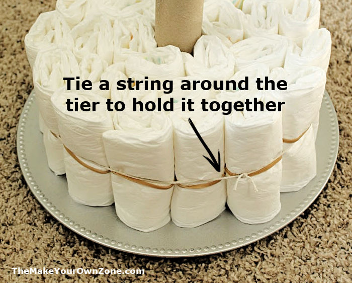 making the first tier of a 3 tier diaper cake