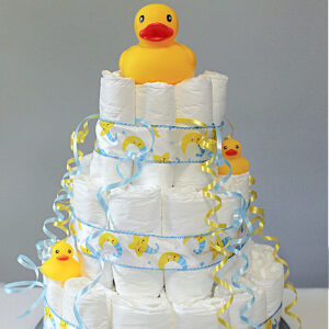 A rubber duck on a baby shower diaper cake