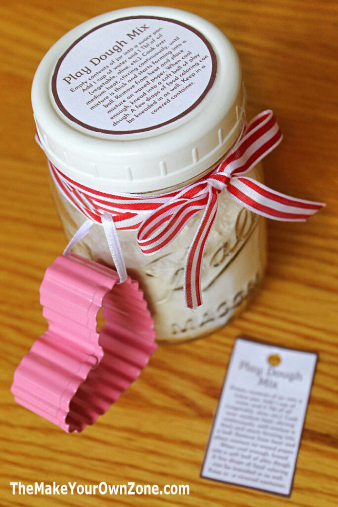 Homemade play dough jar mix in a canning jar with a cookie cutter