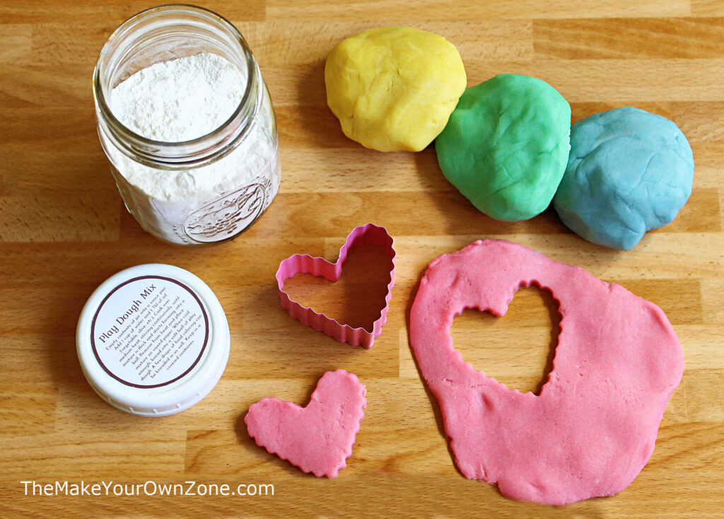 Balls of homemade play dough made from a jar mix gift
